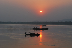 This image has an empty alt attribute; its file name is brahmaputra-sunset.jpg